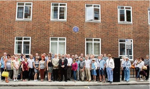 Neil McKenna and everyone under new plaque